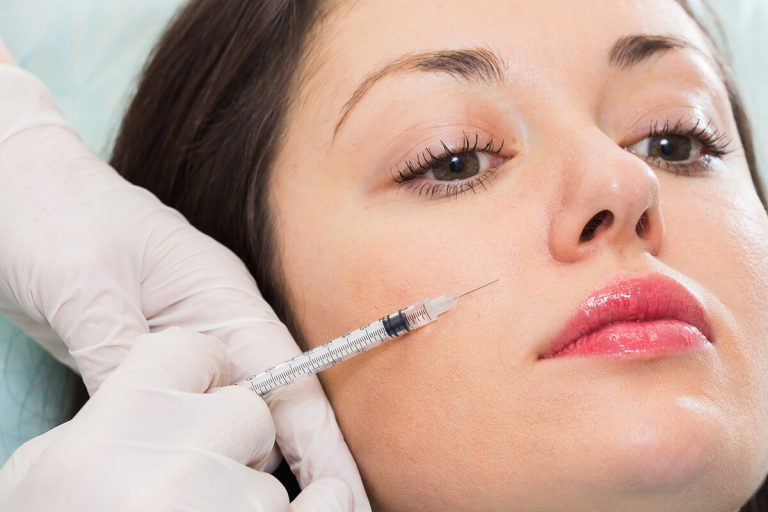 Woman getting Botox injection on the face